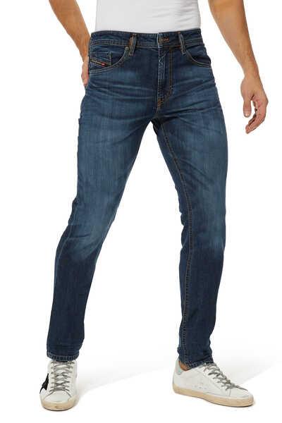 بنطال جينز تومر إكس بقصة ضيقة
