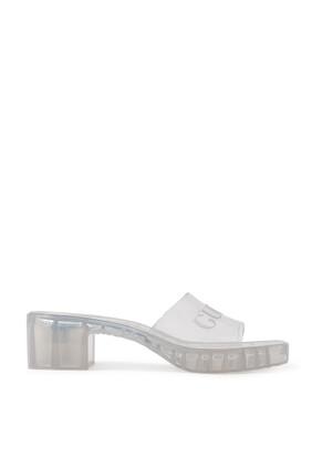 حذاء شفاف مفتوح من الخلف بشعار الماركة